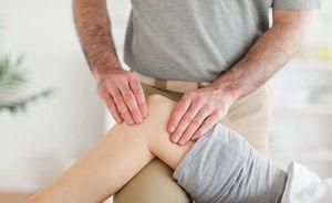 Причины болей в колене